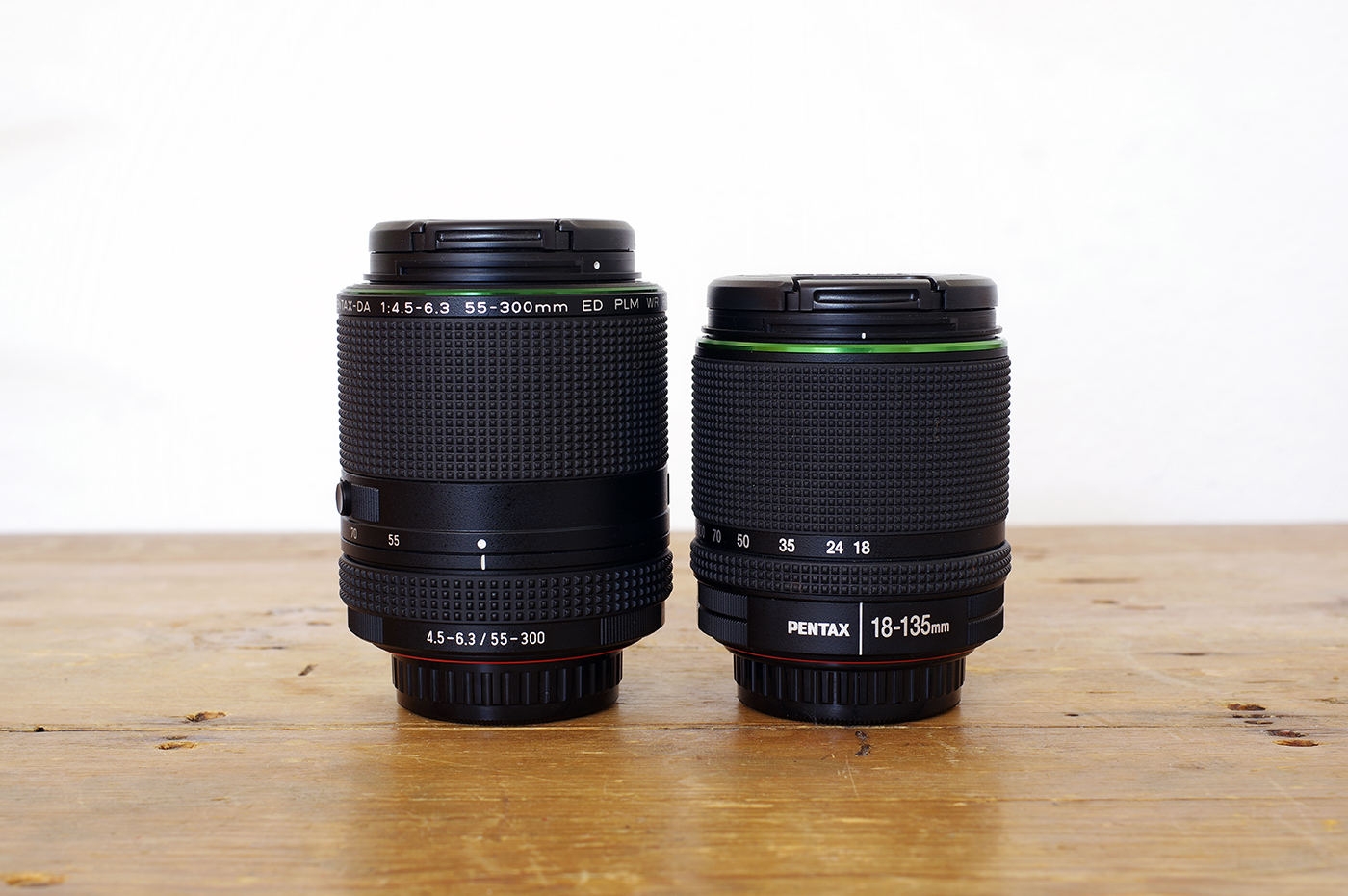 The 55-300mm PLM is slightly longer and wider than the DA 18-135mm WR.
